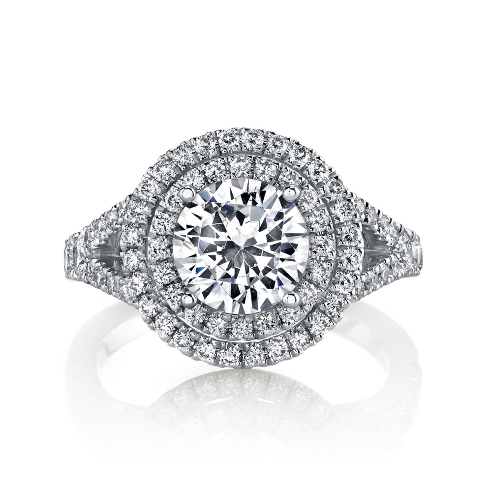 Contemporary designer diamond halo engagement ring by Parade Design.